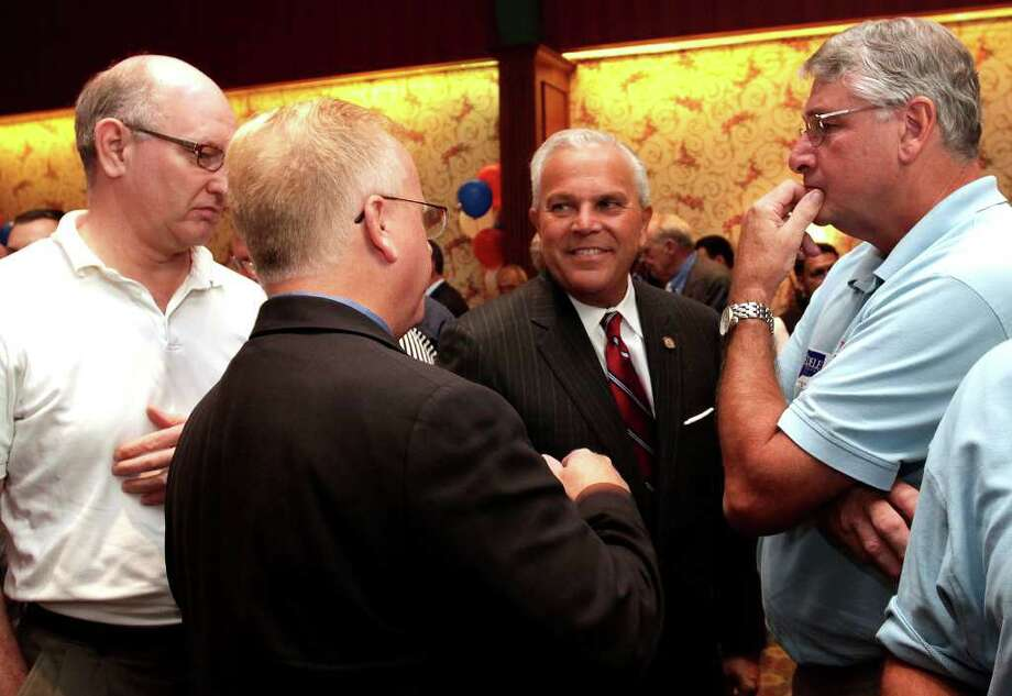 Michael Fedele, center, running for Governor of Connecticut, chats with Jeff Muthersbaugh, of Bethel, Mayor Mark Boughton, and Gregg Seabury, of Danbury during primary election night at the Italian Community Center in Stamford, August 10, 2010. Photo: Chris Ware