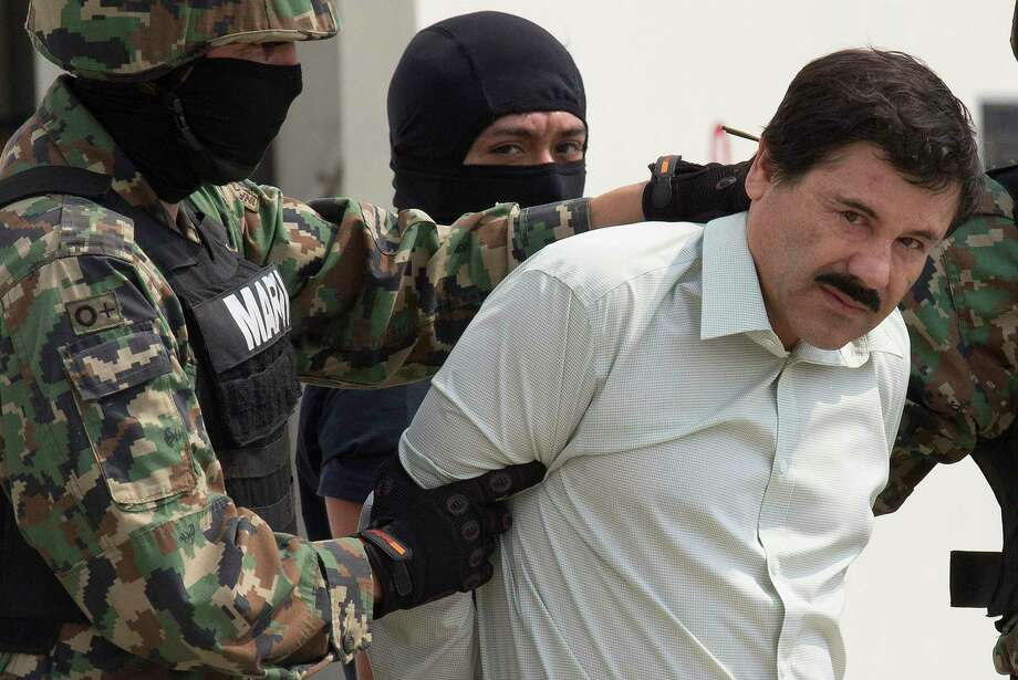 """Drug trafficker Joaquin """"El Chapo"""" Guzman is escorted to a helicopter by Mexican security forces at Mexico's International Airport in Mexico city, Mexico, Feb. 22, 2014. A reader suggests legalizing drugs to reduce cartel crime. Photo: Susana Gonzalez /Bloomberg / © 2014 Bloomberg Finance LP"""