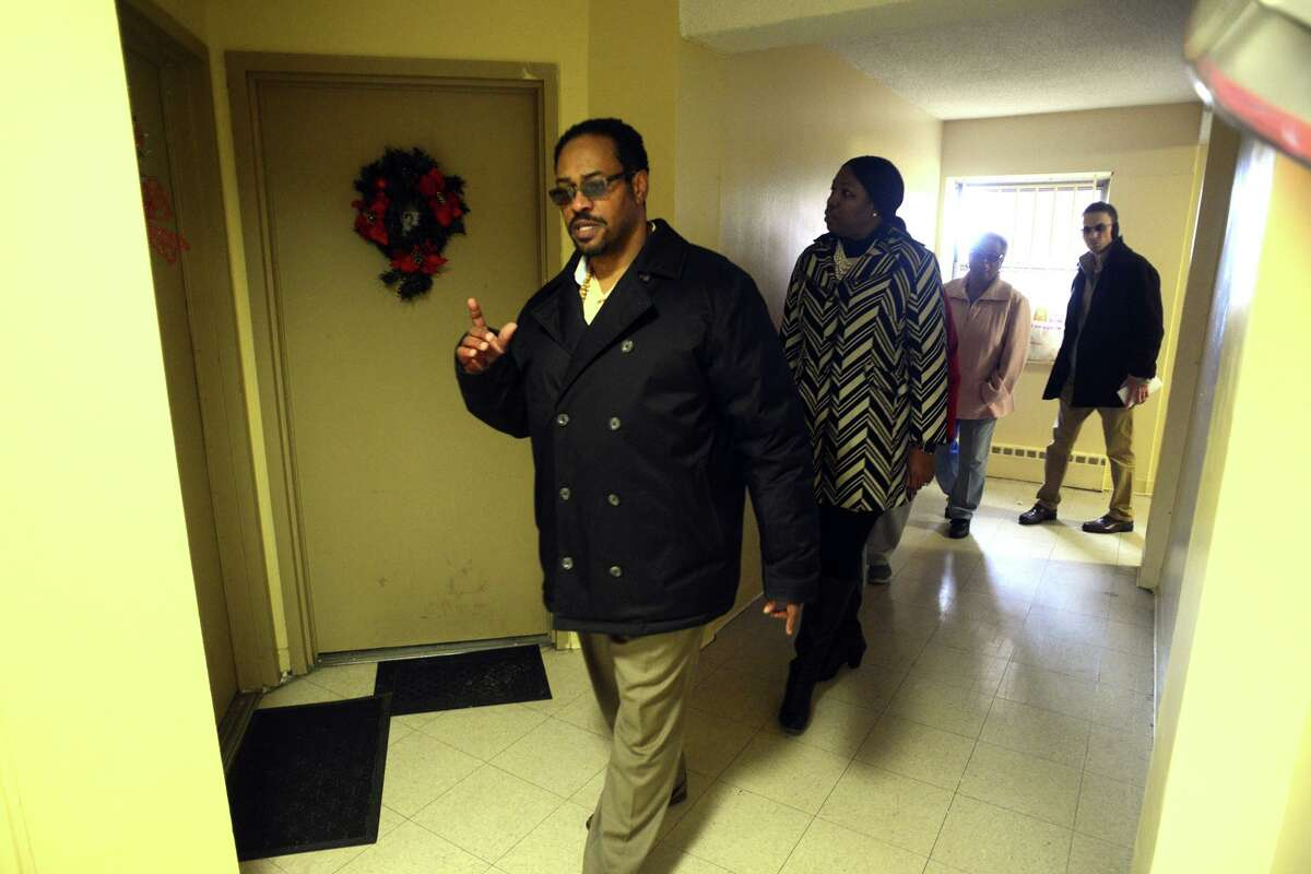 Tony Manley of the Bridgeport Housing Authority leads a tour through one of the buildings of the Charles F. Greene homes, in Bridgeport, Conn. Dec. 17, 2018. On Monday the City of Bridgeport announced new efforts to clean and maintain the aging housing complex.