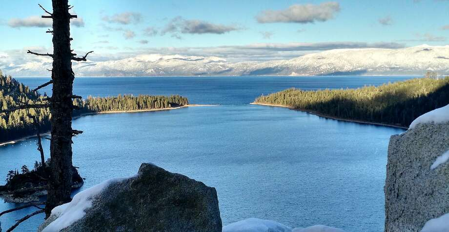 Fall's first snow dusted the Tahoe Basin, seen from the Inspiration Point Lookout over Emerald Bay and Lake Tahoe. Nine ski areas are planning limited openings by Thanksgiving. Photo: Tom Stienstra / The Chronicle