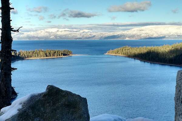 Fall's first snow, long since melted off, dusted the Tahoe Basin, seen from the Inspiration Point Lookout over Emerald Bay and Lake Tahoe