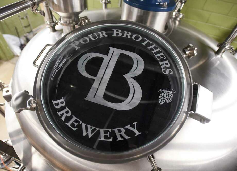 The logo of Pour Brothers Brewery frosted on the glass of one of their tanks at the brewery Tuesday. Photo taken on Monday, 09/09/19. Ryan Welch/The Enterprise Photo: Ryan Welch,  Beaumont Enterprise / The Enterprise / © 2019 Beaumont Enterprise