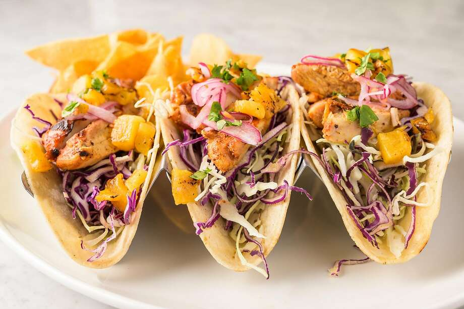 The tacos at Bourbon Pub have chicken al pastor and charred pineapple. Photo: Bourbon Pub