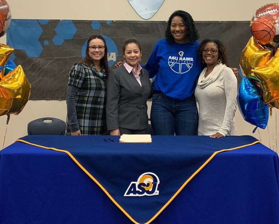 Judson Early College Academy staff (from left) Marissa Martinez, counselor, Dr. Josephine Juarez, principal, and Monique Broadnax, senior college prep teacher (right) joined Aleesha Orange at the signing. Photo: Photo Courtesy Judson ISD