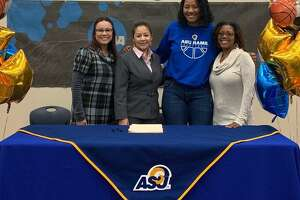 Judson Early College Academy staff (from left) Marissa Martinez, counselor, Dr. Josephine Juarez, principal, and Monique Broadnax, senior college prep teacher (right) joined Aleesha Orange at the signing.