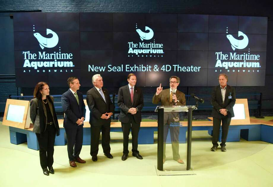 Maritime Aquarium President and CEO Jason Patlis speaks at the podium beside others closely involved with improvements during the groundbreaking ceremony at the Maritime Aquarium in Norwalk, Conn. Monday, Nov. 18, 2019. The Maritime Aquarium has begun construction on a larger, improved seal exhibit and new 4D theater. Photo: Tyler Sizemore / Hearst Connecticut Media / Greenwich Time
