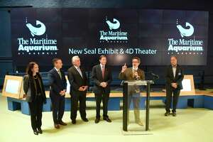 Maritime Aquarium President and CEO Jason Patlis speaks at the podium beside others closely involved with improvements during the groundbreaking ceremony at the Maritime Aquarium in Norwalk, Conn. Monday, Nov. 18, 2019. The Maritime Aquarium has begun construction on a larger, improved seal exhibit and new 4D theater.