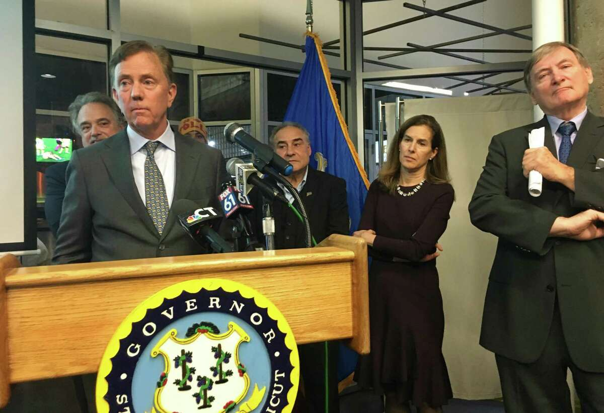 Gov. Ned Lamont, rolled out his transportation plan on Nov. 7 in Hartford with $320 million in annual toll collections that died soon after, but could be revived in 2021. He's surrounded by people from the administration and supporters including Transportation Commissioner Joe Giulietti; AFL-CIO president Sal Luciano; Lt. Gov. Susan Bysiewicz; and at right, Joe McGee of the Business Council of Fairfield County.
