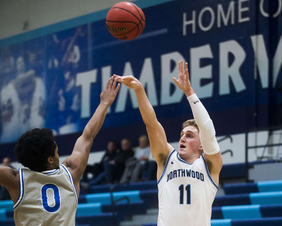 Northwood's Jack Ammerman puts up a 3-pointer during last week's win over Great Lakes Christian. Photo: Daily News File Photo