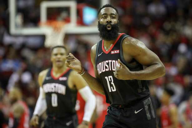 Houston Rockets guard James Harden (13) celebrates during the second quarter of an NBA basketball game at the Toyota Center on Monday, Nov. 18, 2019, in Houston.