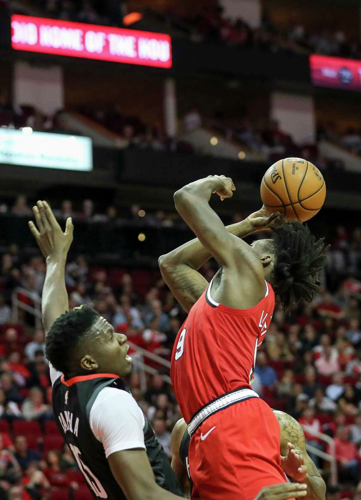 Portland Trail Blazers forward Nassir Little (9) fouls Houston Rockets center Clint Capela (15) during the second quarter of an NBA basketball game at the Toyota Center on Monday, Nov. 18, 2019, in Houston.