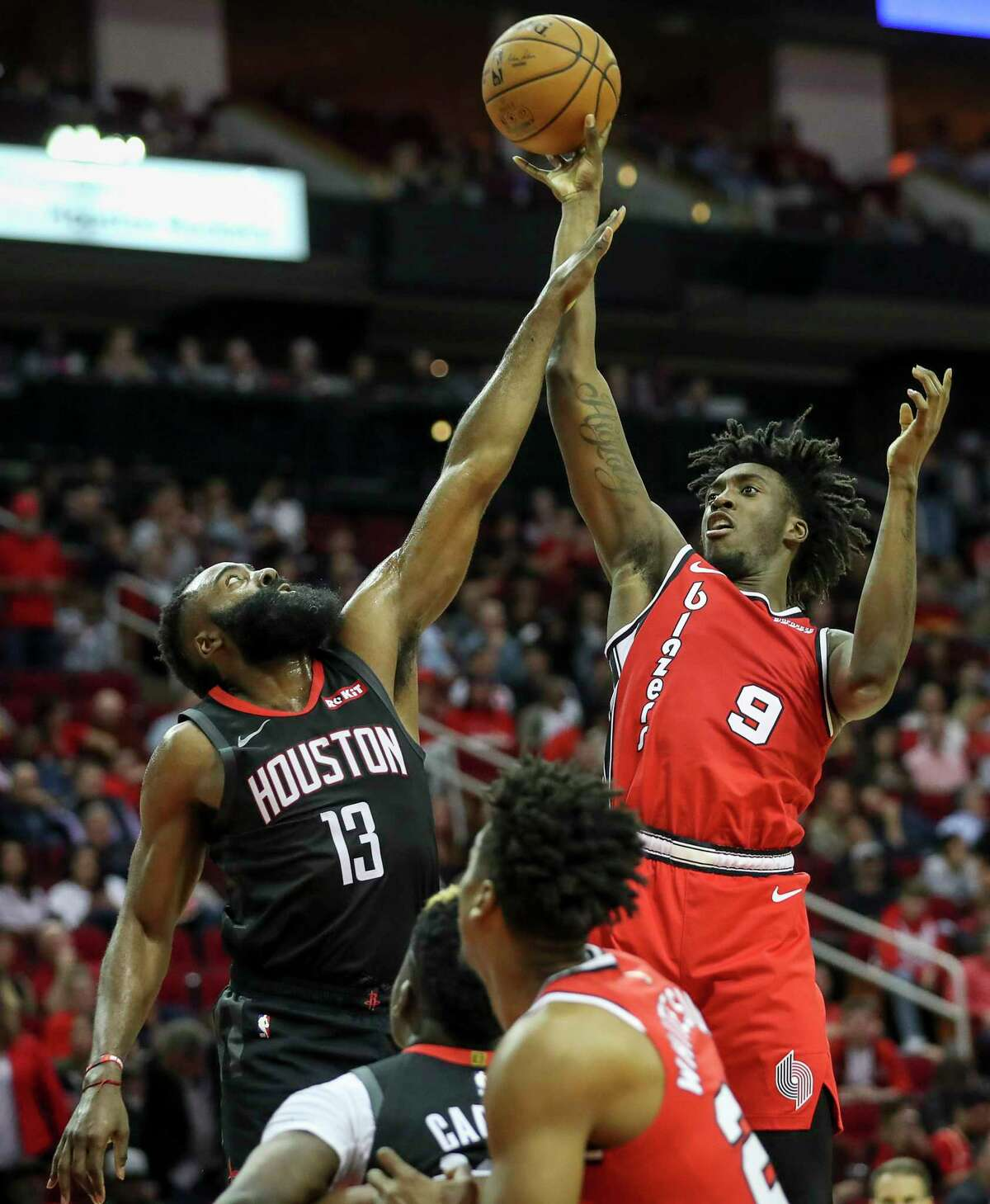 Portland Trail Blazers forward Nassir Little (9) shoots over Houston Rockets guard James Harden (13) during the second quarter of an NBA basketball game at the Toyota Center on Monday, Nov. 18, 2019, in Houston.
