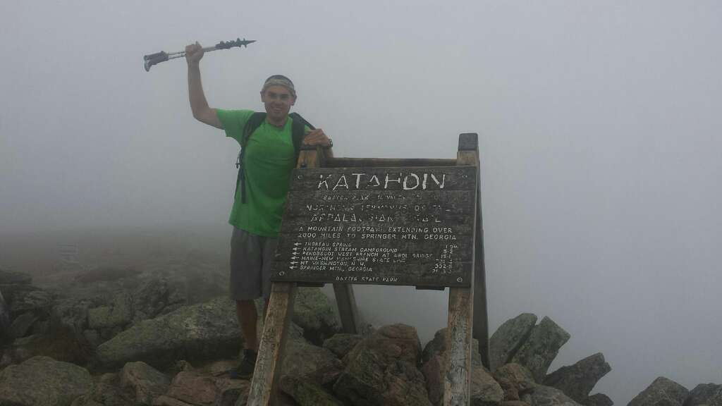 Midland's Travis Glynn is shown at the northernmost point of the Appalachian Trail, part of the prestigious Triple Crown of Hiking that he completed over the past five years.
