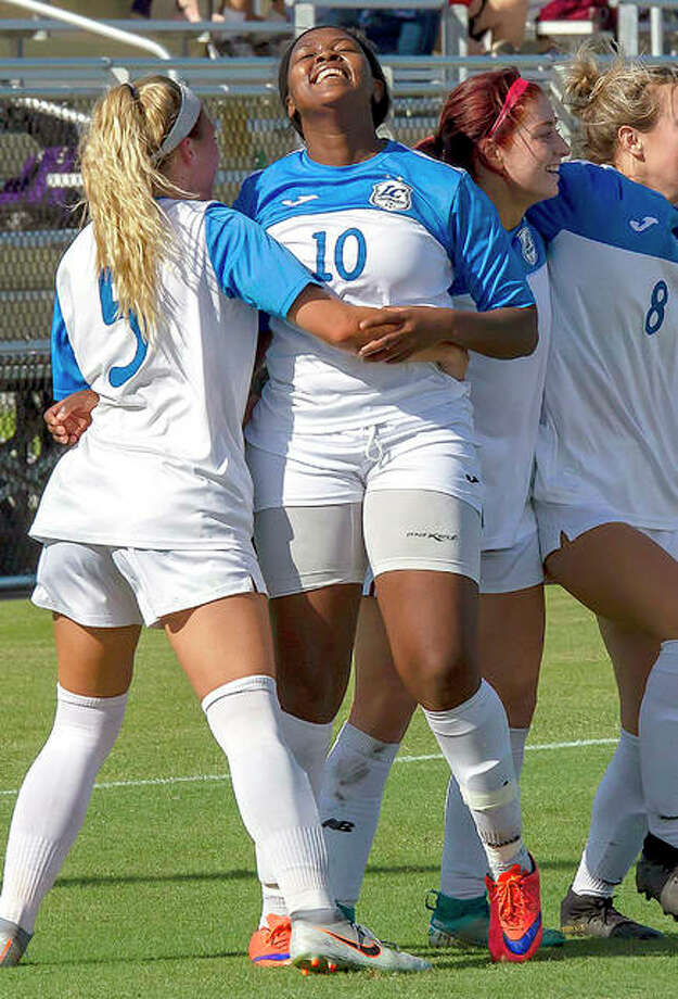 LCCC's Boitumelo Rabale (10) is congratulated by teammates Sydney Schmidt (5), Ella Kiely, middle, and Kara Crutchley (8) after Rabale scored on a 40-yard free kick Monday in their pool play victory over Navarro College at the NJCAA Division I National Tournament in Melbourne, Fla. Photo: Jan Dona | For The Telegraph