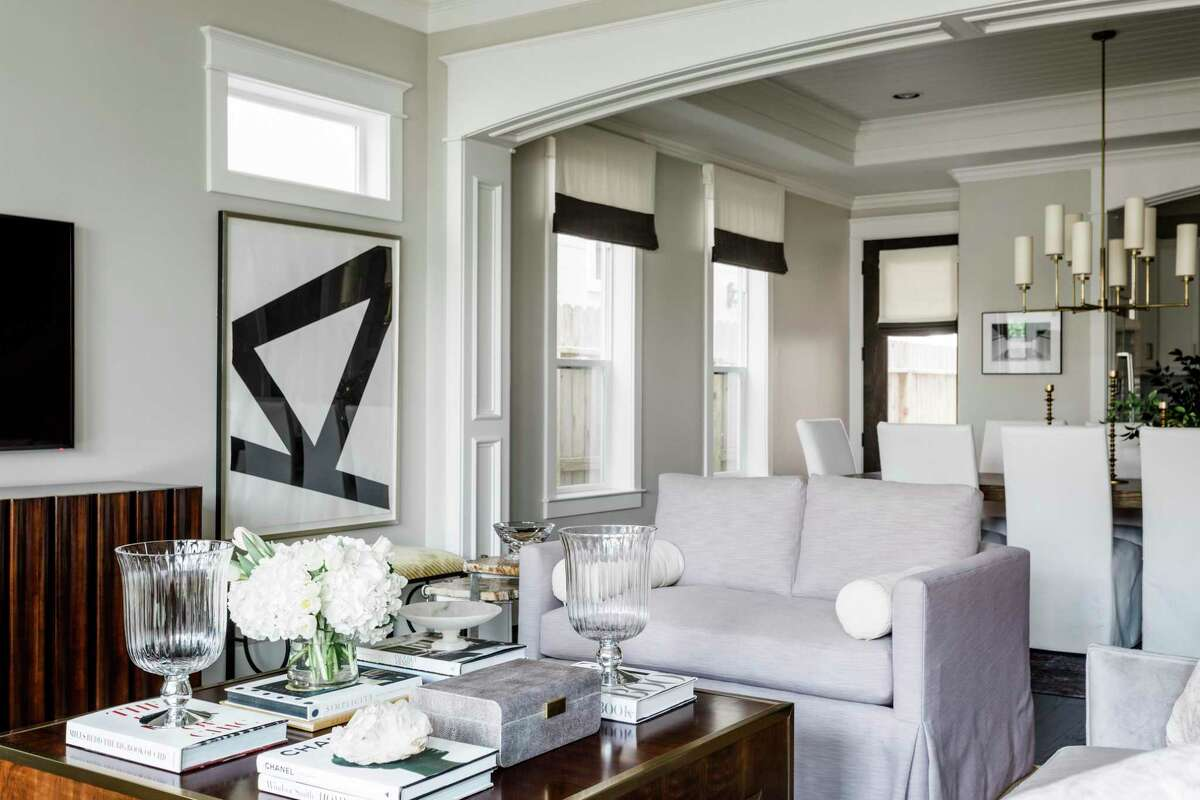 Books make a great accessory in the living room of Houstonians Julia and Andrew Novarini.