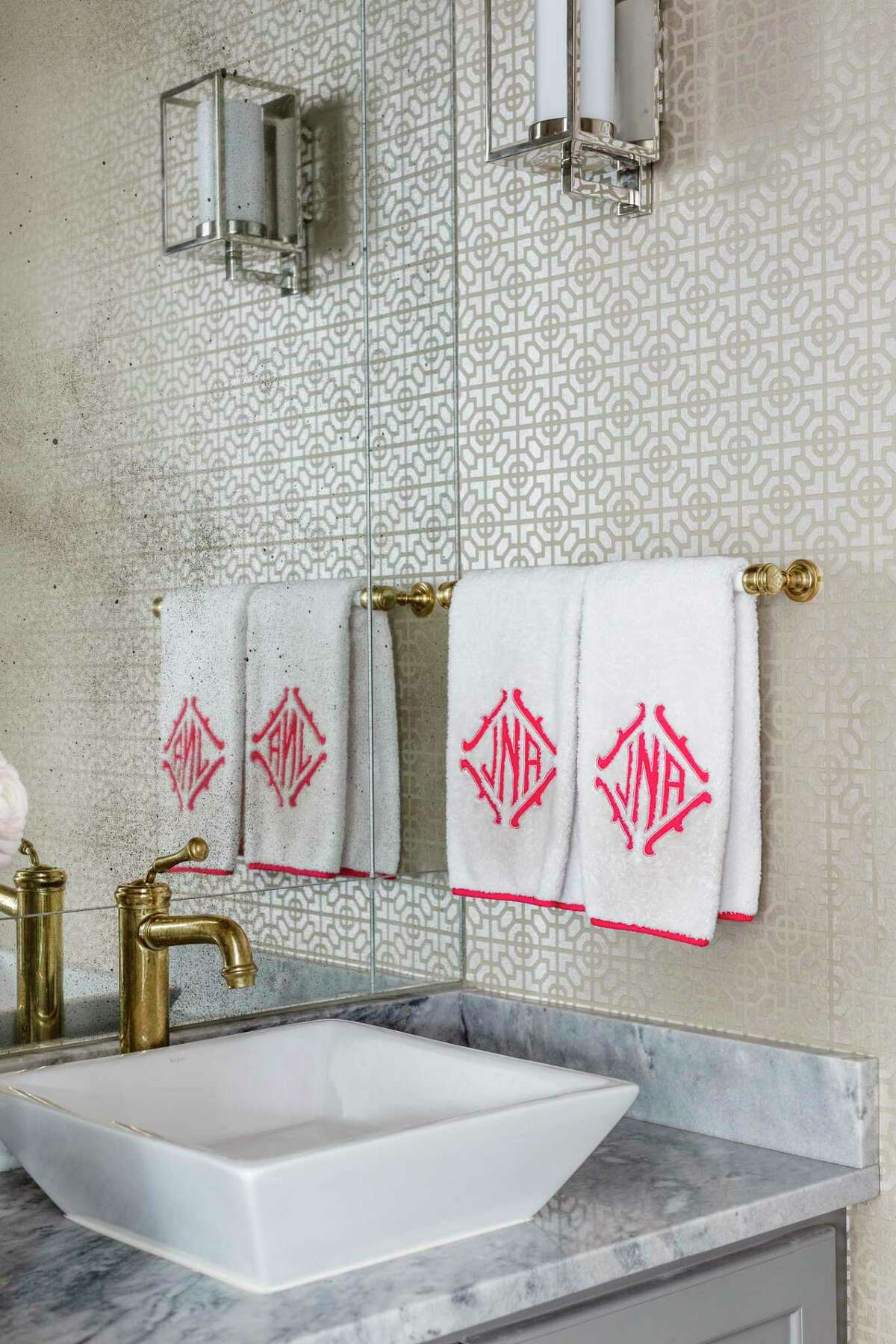 Wallpaper can have a dramatic impact in a bathroom, such as in the Houston home of Julia and Andrew Novarini.