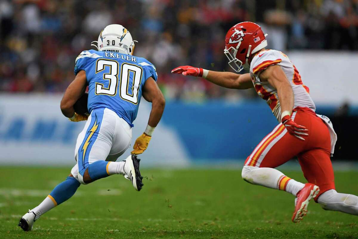 Los Angeles Chargers running back Austin Ekeler (L) runs during the 2019 NFL week 11 regular season football game between Kansas City Chiefs and Los Angeles Chargers on November 18, 2019, at the Azteca Stadium in Mexico City. (Photo by PEDRO PARDO / AFP) (Photo by PEDRO PARDO/AFP via Getty Images)