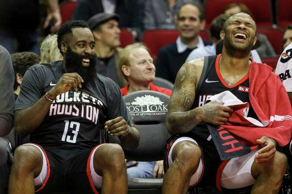 Houston Rockets guard James Harden (13) laughs with Houston Rockets forward PJ Tucker (17) during the fourth quarter of an NBA basketball game at the Toyota Center on Monday, Nov. 18, 2019, in Houston.