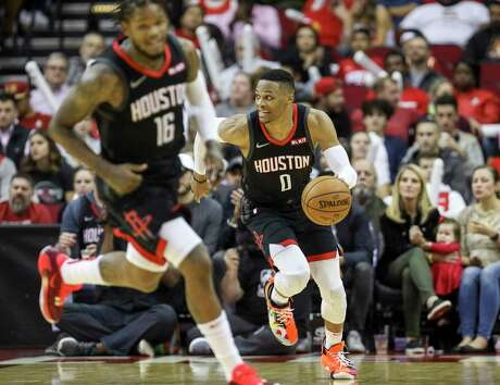 Houston Rockets guard Russell Westbrook (0) moves the ball downcourt during the third quarter of an NBA basketball game at the Toyota Center on Monday, Nov. 18, 2019, in Houston.
