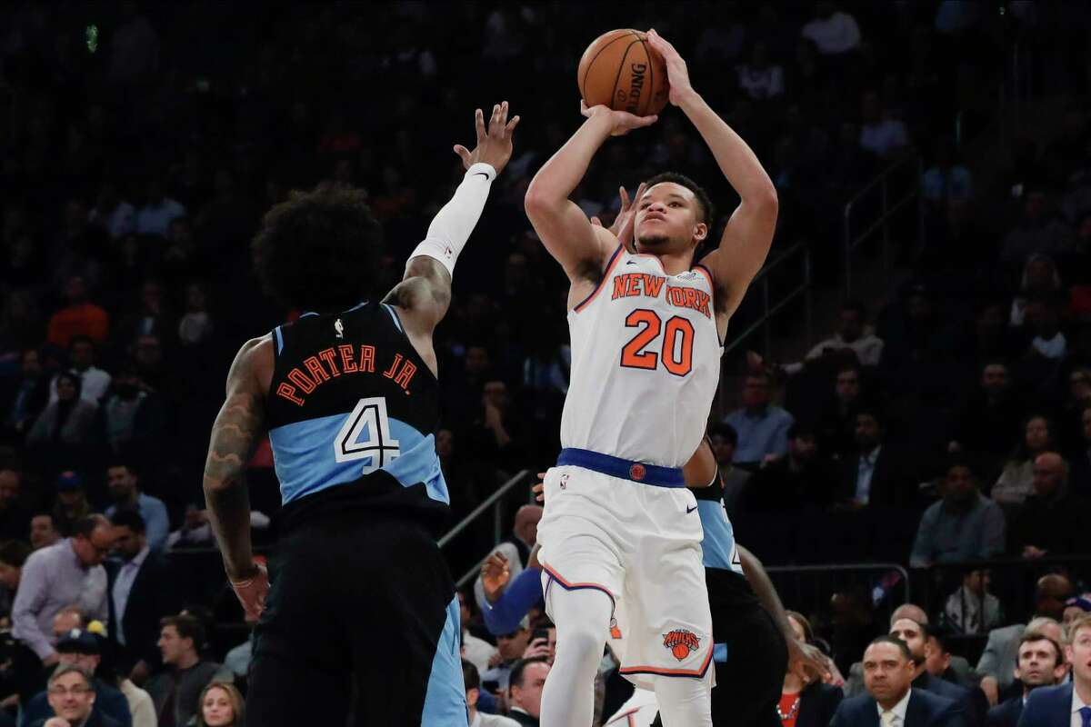 New York Knicks' Kevin Knox II, right, shoots over Cleveland Cavaliers' Kevin Porter Jr. during the first half of an NBA basketball game Monday, Nov. 18, 2019, in New York. (AP Photo/Frank Franklin II)