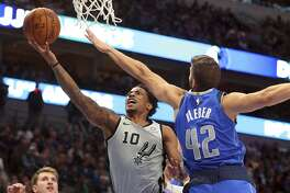San Antonio Spurs guard DeMar DeRozan (10) shoots against Dallas Mavericks forward Maxi Kleber (42) in the second half in an NBA basketball game Monday, Nov. 18, 2019, in Dallas. (AP Photo/Richard W. Rodriguez)