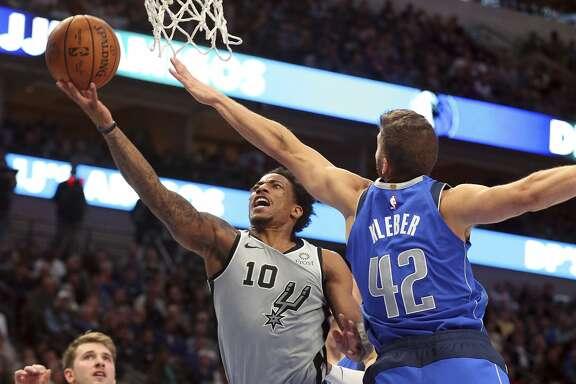 San Antonio Spurs guard DeMar DeRozan (10) shoots against Dallas Mavericks forward Maxi Kleber (42) in the second half in an NBA basketball game Monday, Nov. 18, 2019, in Dallas. (AP Photo/Richard W. Rodriguez)