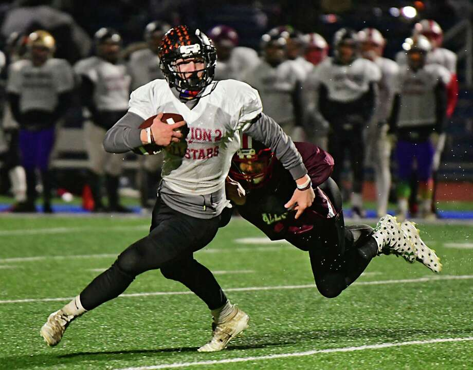 South's quarterback Derek Martelle of Bethlehem carries the ball for a touchdown against the North team during the Exceptional Seniors football game on Monday, Nov. 18, 2019 in Troy, N.Y. (Lori Van Buren/Times Union) Photo: Lori Van Buren / 40048280A