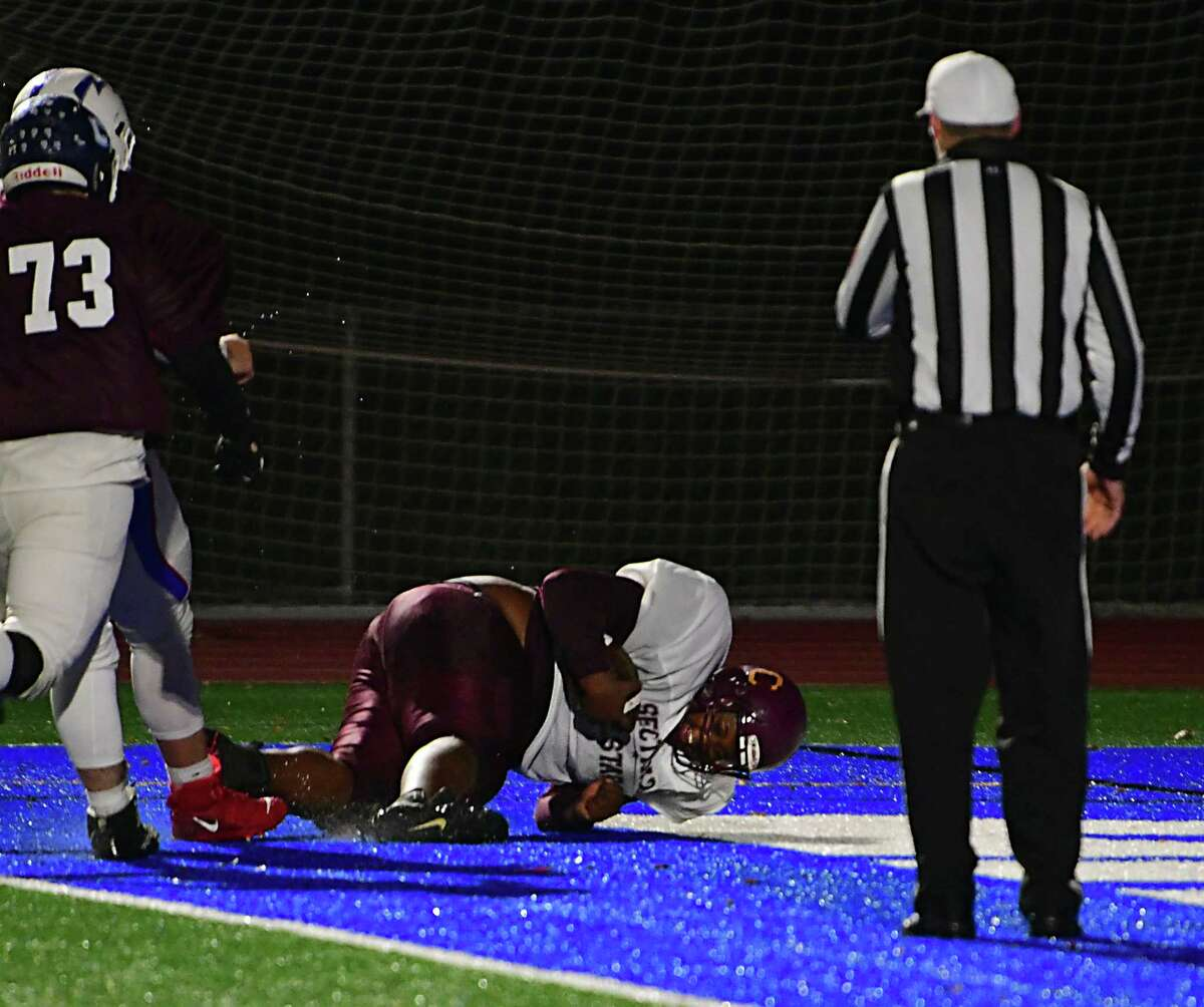 South's offensive lineman RJ Doyal of Tamarac picks up a fumble and carries the ball into the end zone for a touchdown against the North team during the Exceptional Seniors football game on Monday, Nov. 18, 2019 in Troy, N.Y. (Lori Van Buren/Times Union)