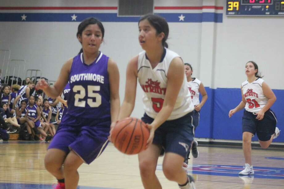 Anabel Zepeda (5) drives the lane against Southmore's Alazae Flores, looking for two of of her nine points in Monday's district contest. Photo: Robert Avery