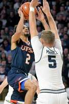 UTSA guard Jhivvan Jackson, left, scored a team-high 15 points, but Utah State's Sam Merrill (5) had the upper hand with 21 points, including five 3-pointers, as the No. 15 Aggies dominated at both ends of the court for a 82-50 victory Monday night in Logan, Utah.