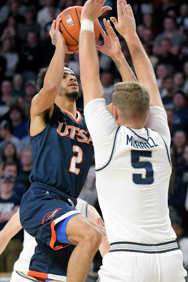 UTSA guard Jhivvan Jackson, left, scored a team-high 15 points, but Utah State's Sam Merrill (5) had the upper hand with 21 points, including five 3-pointers, as the No. 15 Aggies dominated at both ends of the court for a 82-50 victory Monday night in Logan, Utah. Photo: Eli Lucero / Associated Press / Copyright 2019 The Associated Press. All Rights Reserved