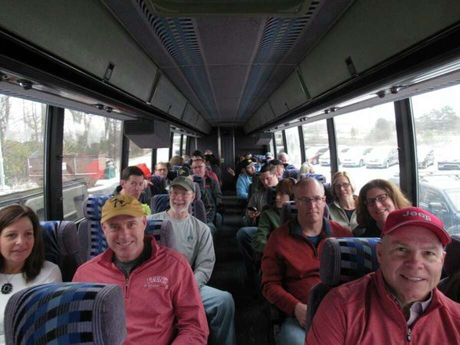 Midland hockey players and their family members are shown during a bus ride to the University of Michigan's Yost Ice Arena, where the players competed for one hour on Saturday, Nov. 9. Everyone stayed to watch the game that evening between Michigan and Minnesota. (Photo provided)