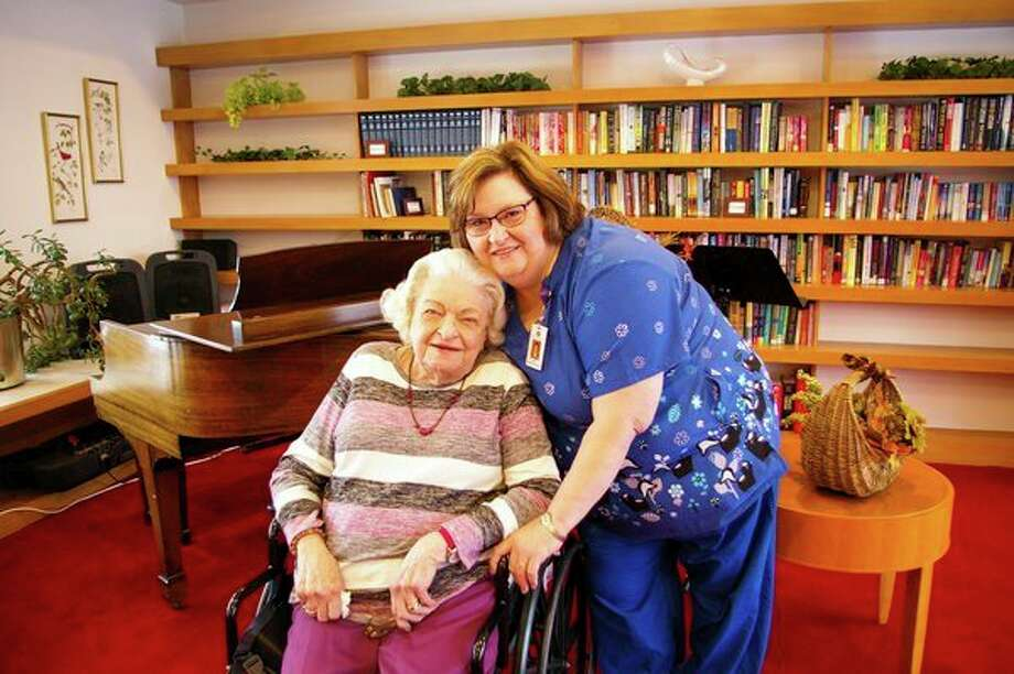 Deborah McDonough is this year's winner of the Michigan Center for Assisted Living's Alice B. Wallace Care Giver Award. Here she is pictured with Mary Jane Boomer, a resident at Midland King's Daughters, where McDonough has worked for nearly 32 years. (Photo for the Daily News byNiky House)