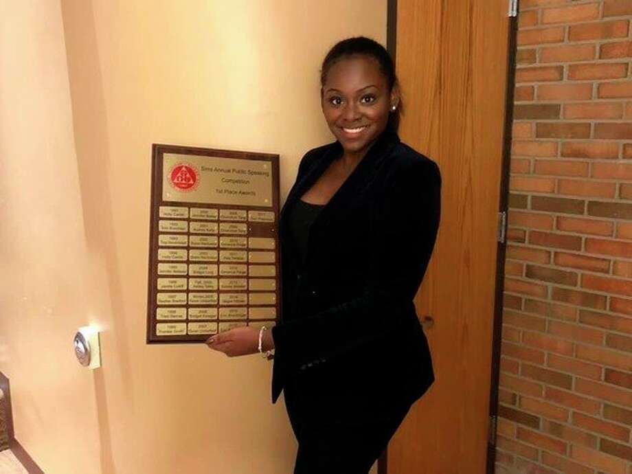 Simone Vaughn holds a plaque dedicated to the winners of the Sims Public Speaking Competition. Vaughn won the 2019 contest. (Photo provided/SVSU)