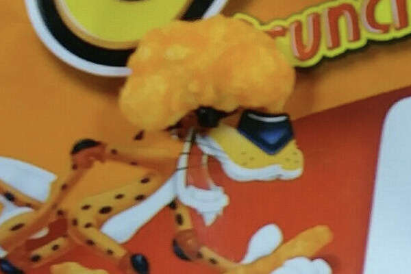 The person who found the presidential-hairdo Cheeto used the snack food's mascot, Chester Cheetah, to illustrate the likeness.