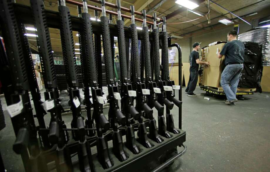 FILE - In this April 10, 2013 file photo, newly made AR-15 rifles stand in a rack at Stag Arms in New Britain, Conn.  (AP Photo/Charles Krupa, File) Photo: Charles Krupa / Associated Press / AP