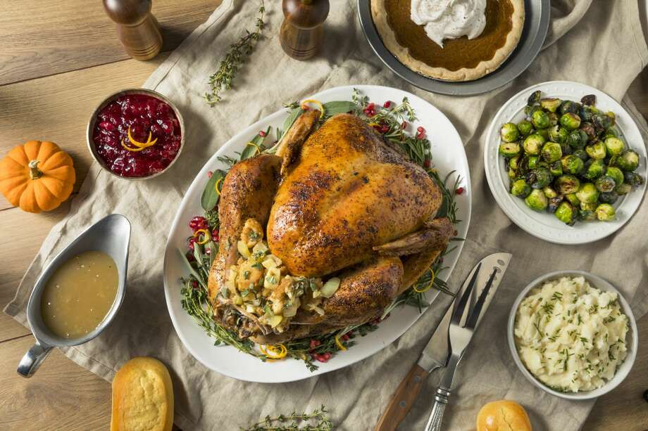 Whole Roasted Turkey Dinner For Thanksgiving with All the Sides Photo: Bhofack2/Getty Images/iStockphoto