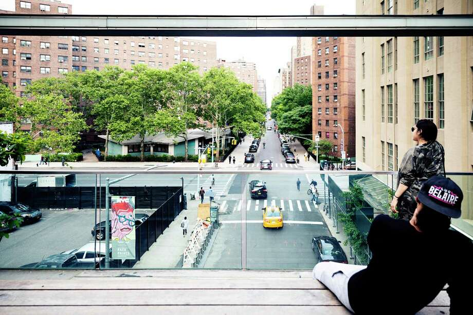 A viewing booth overlooks 25th Street on the High Line, an elevated New York City public park on a repurposed rail line, on June 4, 2018. Washington Post photo by Jesse Dittmar Photo: Jesse Dittmar, The Washington Post / The Washington Post