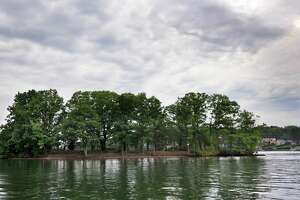 Sand Island, one of about 20 islands on Candlewood Lake, is in the New Fairfield, Conn. portion, Thursday, July 11, 2013.