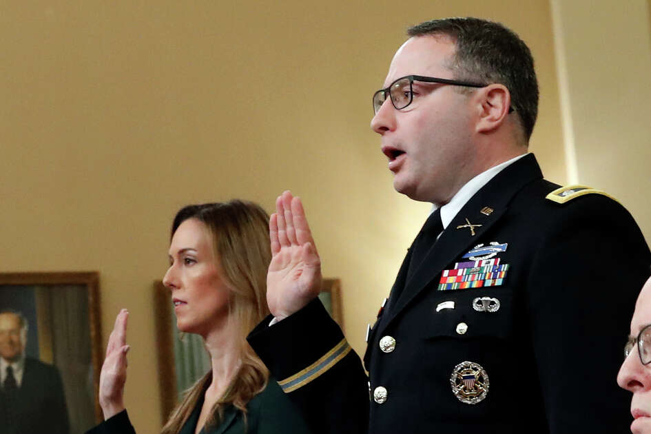 Jennifer Williams, an aide to Vice President Mike Pence, and National Security Council aide Lt. Col. Alexander Vindman, are sworn in before they testify before the House Intelligence Committee on Capitol Hill in Washington, Tuesday, Nov. 19, 2019, during a public impeachment hearing of President Donald Trump's efforts to tie U.S. aid for Ukraine to investigations of his political opponents.