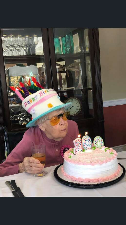 Ada Wellock Lucke blows out the candles on her birthday. Lucke celebrated her 100th birthday with a bash at Crosby Commons. Photo: Contributed Photo / Connecticut Post