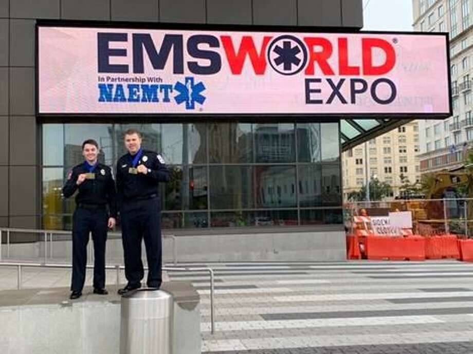 Montgomery County Hospital District paramedics Russell Carter, left, and Justin Ward are seen in October at the EMS World Expo in New Orleans after winning a national contest there. Photo: Courtesy Of The Montgomery County Hospital District