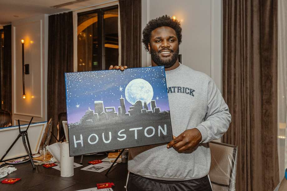PHOTOS: Texans vs. Ravens  Texans' D.J. Reader 'Captures the Moon!' at the newly opened Cambria Hotel Houston Downtown Convention Center's VIP paint night event. >>>See more photos from the Texans' game against Baltimore on Sunday ...  Photo: Contributed Photo