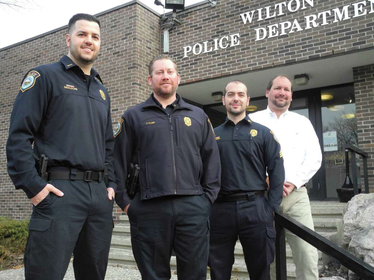 Wilton police taking part in No Shave November are, from left, Officer Robert Smaldone, Training Officer Michael Tyler, Sgt. Steven Rangel, and Detective Scott Sear at police headquarters on Nov. 14.