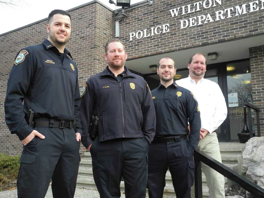Wilton police taking part in No Shave November are, from left, Officer Robert Smaldone, Training Officer Michael Tyler, Sgt. Steven Rangel, and Detective Scott Sear at police headquarters on Nov. 14. Photo: Jeannette Ross / Hearst Connecticut Media / Wilton Bulletin