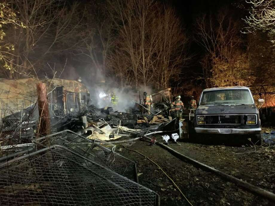Crews from multiple fire agencies responded to a fire that gutted a Candlewood Lake Road home Saturday, Nov. 16. One victim suffered burns to 20 percent of his body, officials said. Photo: Contributed / Brookfield Volunteer Fire Company