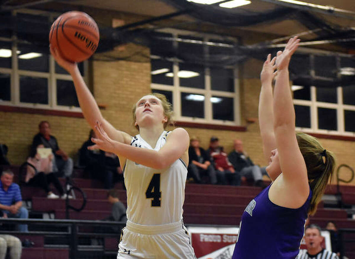 Father McGivney guard Anna McKee lays in a basket in the first quarter against Valmeyer in Dupo.
