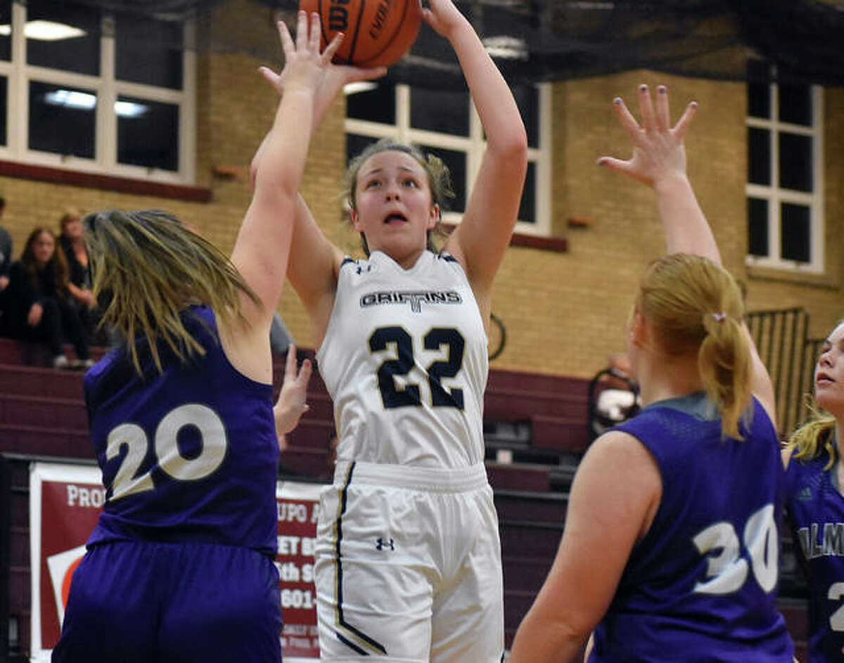 Father McGivney forward Charlize Luehmann goes up for a shot between two Valmeyer defenders in the second quarter.