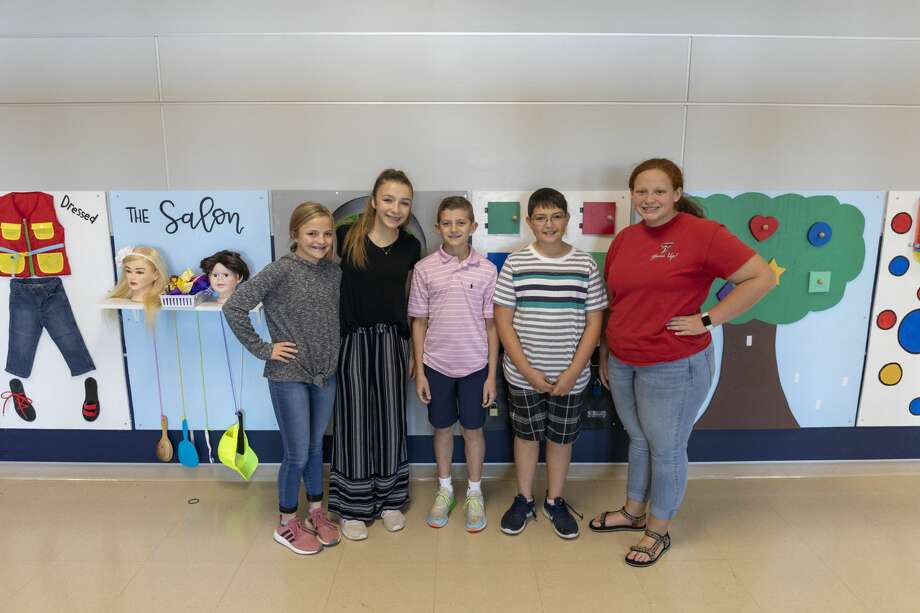 Hannah Creswell, from left, Katelin Somers, Dylan Payton, Jackson Jerez and Micaela Tedder built a sensory hallway for students with special needs at Brooks Middle School in Greenwood. Photo: Jacy Lewis/Reporter-Telegram
