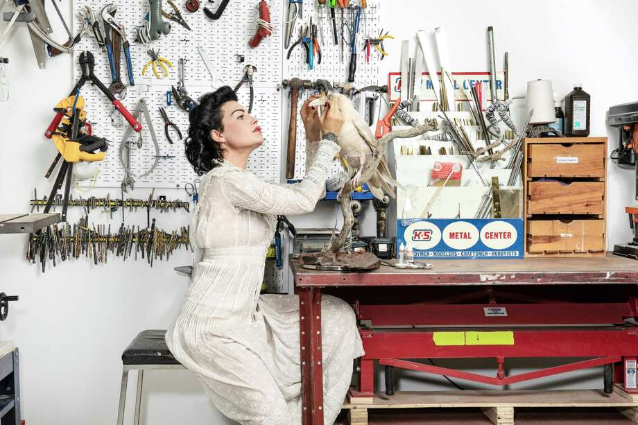 Taxidermist Allis Markham at her home studio at work on Pearl, a rare albino raven. Photo: Photo For The Washington Post By Ian Maddox / For The Washington Post